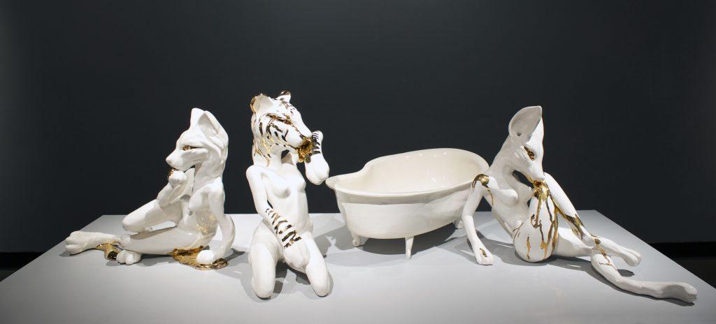 student ceramic work of anthropomorphic animals