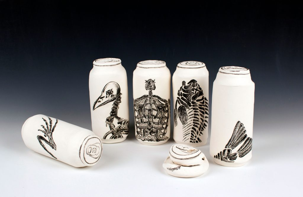 student ceramic work of cans with bird skeletons printed on them