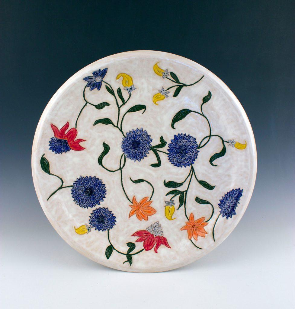 student ceramic work of decorative plate