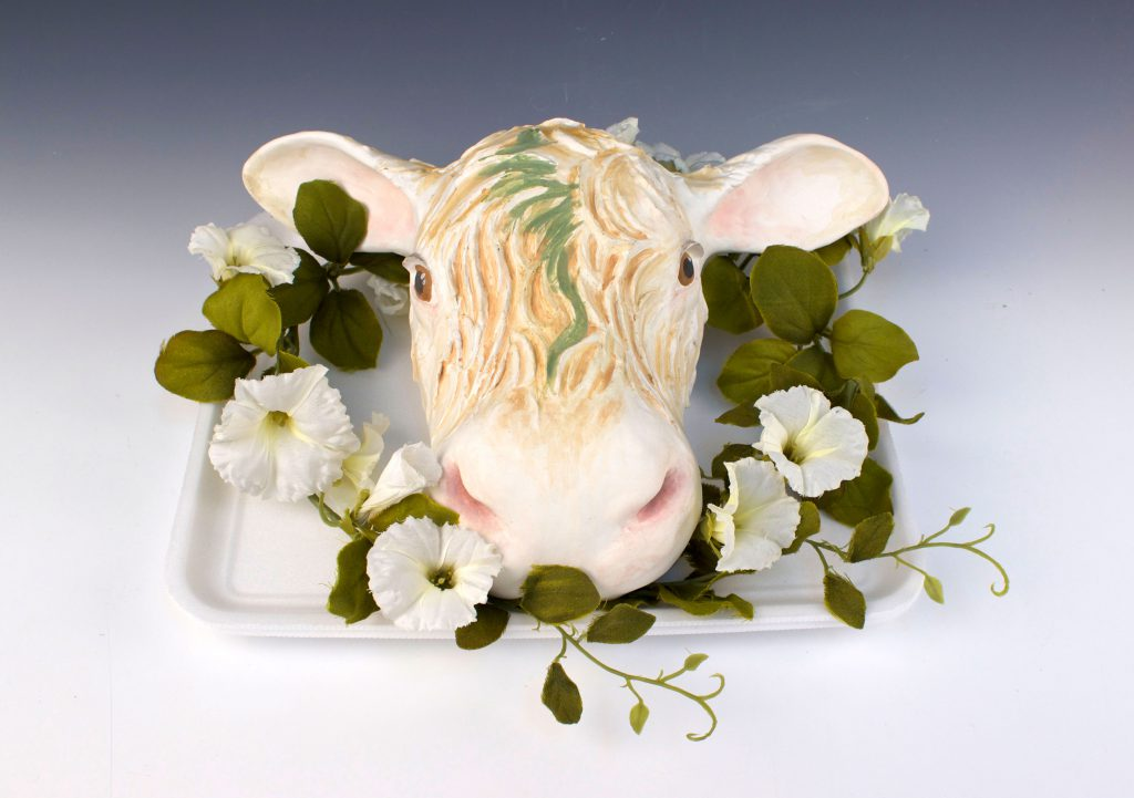 student ceramic work of cow head on a tray