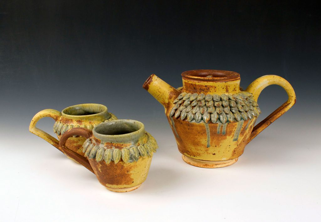 ceramic cups and teapot