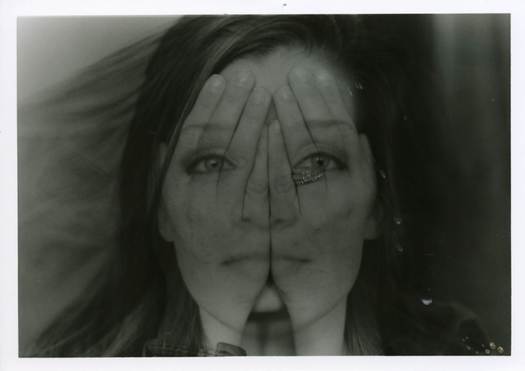 photo depicting double exposure of hands and face