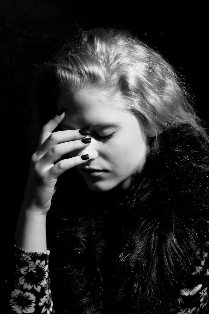 studio portrait image of young woman