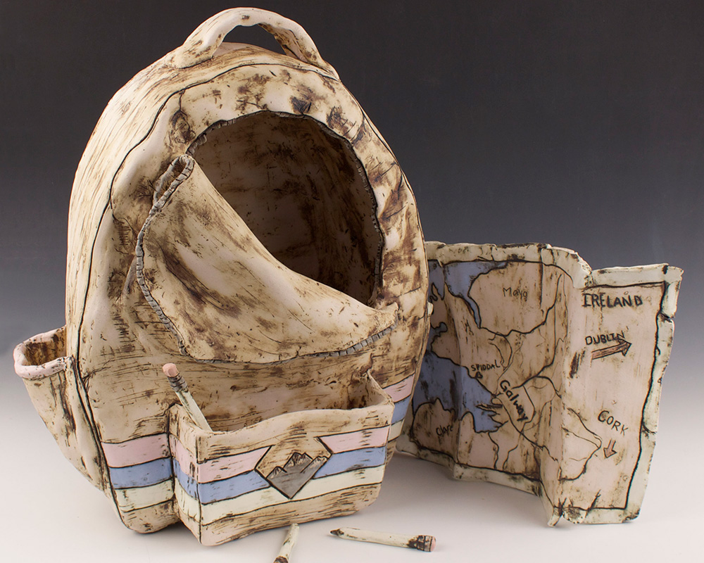 student ceramic work of backpack and map