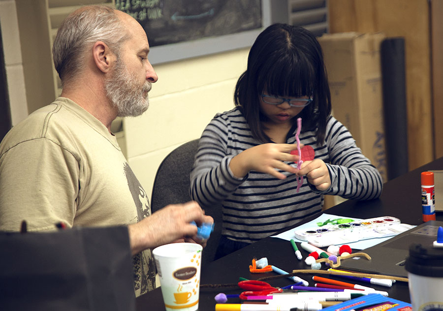 Art Ed student working with a child