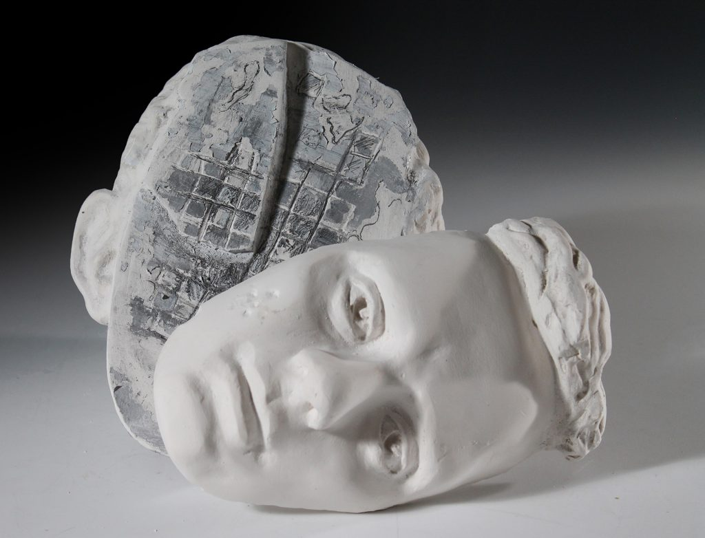 student sculpture of bisected head