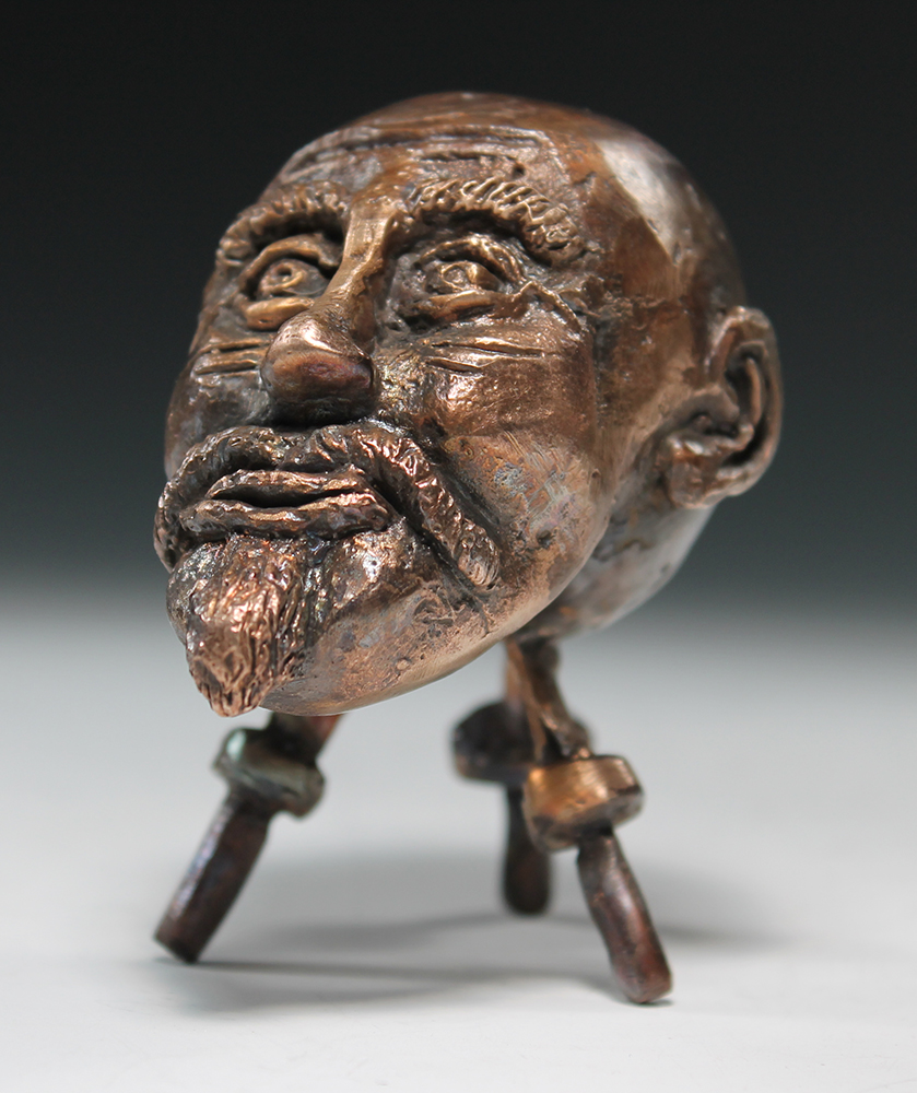 student sculpture of an old man's head