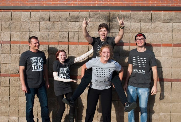 UNK art students wearing t-shirts to benefit Hurricane and Fire relief
