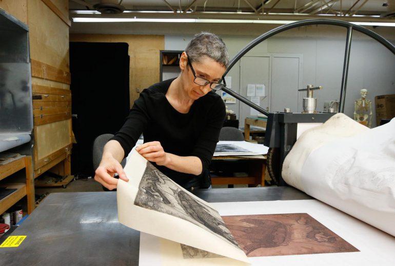 Professor Goro-Rapoport pulling print from a copper plate