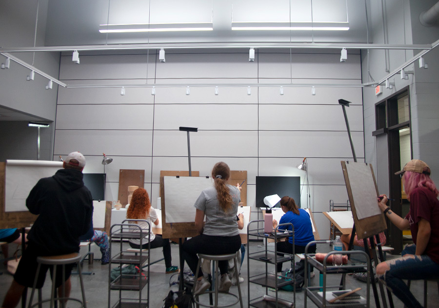 students drawing a still life