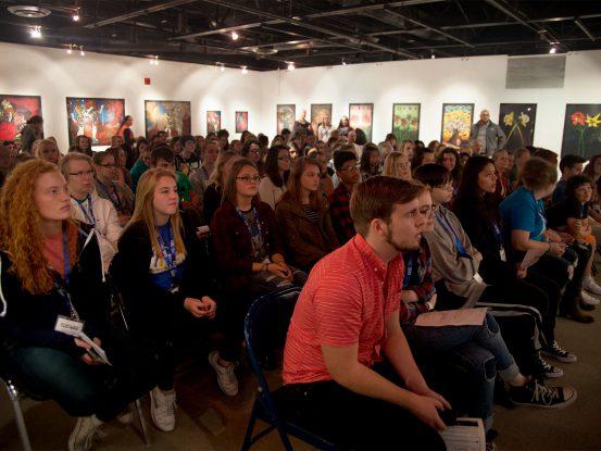 Students listening to speaker in the Walker Gallery