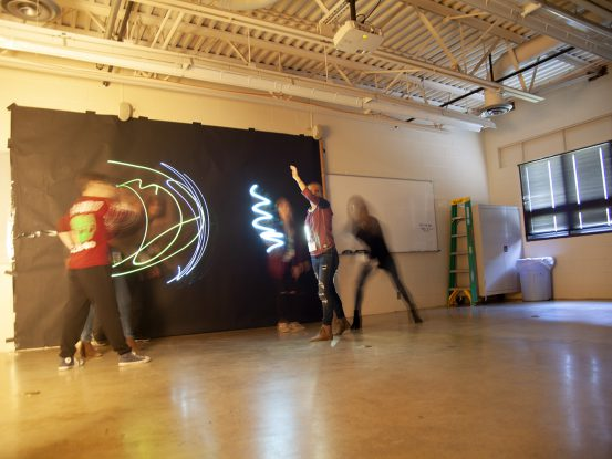 students light painting in photography workshop