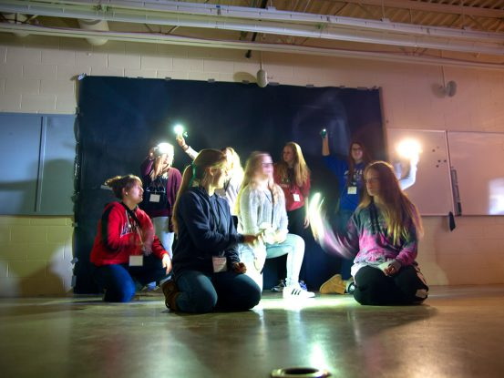 high school students creating light paintings
