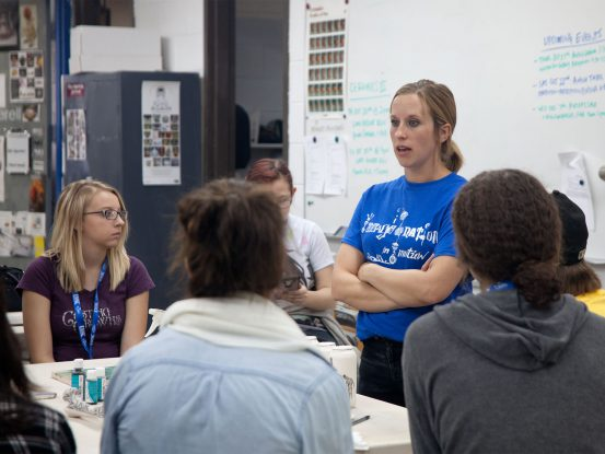 Professor Wetherell speaking to high school students