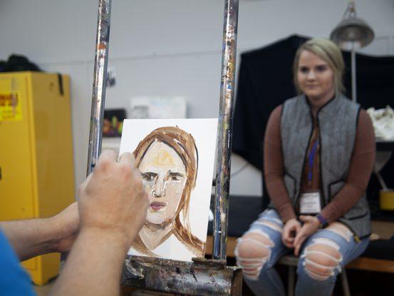 high school getting her portrait painted by Professor Waterfield