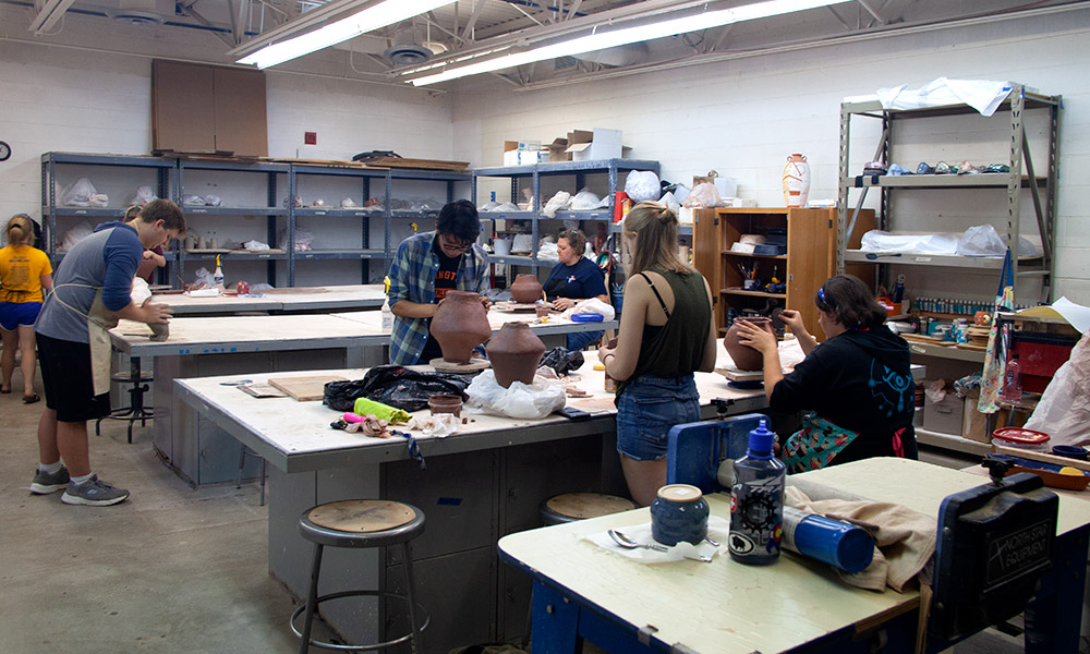 students working in ceramics class